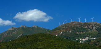 Windmill on corsica island. Landscape and windmill from corsica cape Royalty Free Stock Image