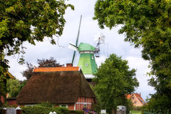 Windmill and Cottage at Altes Land village. Thatch roof cottage and old windmill at Altes Land, Germany stock photos