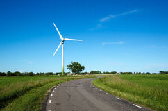 Windmill by a country road side Royalty Free Stock Image