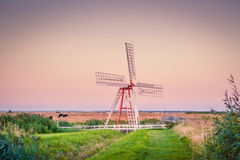 Windmill on a countryside Stock Images