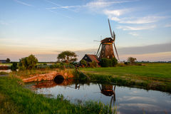 Windmill in the countryside in Holland Stock Images
