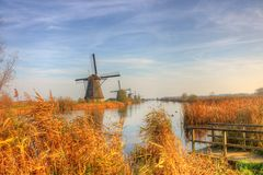 Windmill in Countryside kinderdijk. Countryside-style is a special characteristic for this picture, old-fashion windmill stand in a row and during the lazy Royalty Free Stock Photos
