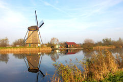 Windmill in Countryside kinderdijk. Countryside-style is a special characteristic for this picture, old-fashion windmill stand in a row and during the lazy Stock Photo