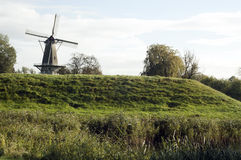 Windmill in the countryside. Countryside portraying a windmill on hill in Brabant, the Netherlands. Nature photography nearby Sleeuwijk en Woudrichem stock photography