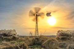 Windmill countryside. Windmill standing in the open fields Royalty Free Stock Photos