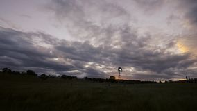 Windmill in the countryside. Windmill in the countryside of Queensland, Australia stock video footage