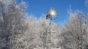 Windmill covered in snow in the winter