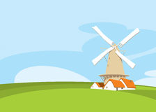 Windmill and cow in nature Royalty Free Stock Photos
