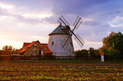 Windmill in Czech Republic. This century old windmill stands in the south of Czech Republic. It`s still used for production and the arable land can be seen in royalty free stock photos