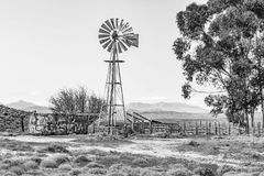 Windmill, dam and a kraal. Monochrome Stock Photography
