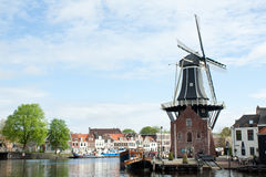 Windmill De Adriaan in Harlem in North Holland . Photo taken on: May, 2012. Windmill De Adriaan in Harlem on River Spaarne in North Holland. Landscape Stock Image