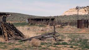 Windmill dead wood landscape. Material on desolate meadow stock footage