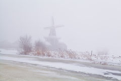 Windmill in dense fog Royalty Free Stock Photos