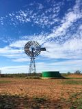 Windmill in the Desert in Australia. Do you need water in the middle of nowhere? Windmill with green water well in the Desert in Australia royalty free stock photos
