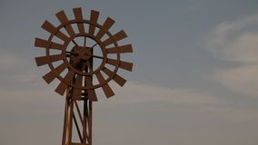 Windmill at desert in mist.  stock video footage