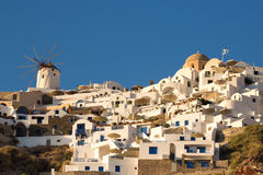 Windmill and different hotels at Oia Royalty Free Stock Photography