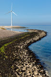 Windmill on a dike. A windmill on a sea dike that is a part of the Oosterscheldekering (Delta Works) in the Netherlands Stock Photography