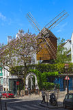 Windmill of the district of Montmartre in Paris. Royalty Free Stock Photos