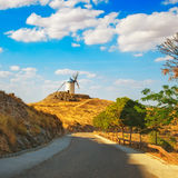 Windmill of Don Quixote and road in Consuegra. Castile La Mancha Royalty Free Stock Photo