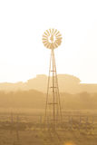 Windmill and dry dusty landscape. Australia. Royalty Free Stock Images