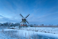 Windmill in dusk during winter morning Stock Photography