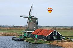 The windmill in Dutch countryside Royalty Free Stock Image