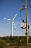 Windmill and electrical substation Stock Photos