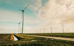 Windmill Energy on Green Grass Field royalty free stock photo
