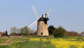 Windmill in a n English rural landscape Royalty Free Stock Photography