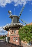 Windmill Esens vertical with blue sky Royalty Free Stock Images
