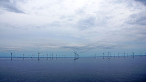 Windmill farm in the Baltic Sea Royalty Free Stock Image