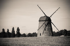 Windmill on farm field Stock Photography
