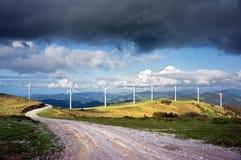 Windmill farm in mountain Stock Image