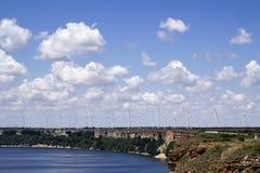 Windmill farm near the sea Stock Photos