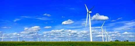 Windmill Farm Panorama. Windmills in a cornfield Stock Photos
