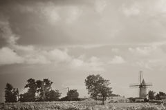 Windmill in the farm Stock Photos