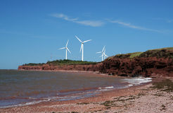 Windmill farm at seaside. Windmills in the distance at North Cape. Prince Edward Island, Canada Stock Photos
