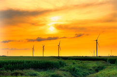 Windmill farm sunset. Newly installed windmills at sunset in Central Indiana. HDR image Stock Photo