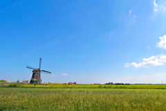 Windmill and farmland Royalty Free Stock Photography