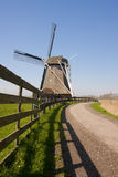 Windmill with fence royalty free stock photos