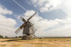 Windmill By The Fence. Photo of a windmill by the fence on the sunny day Stock Image