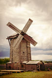 The windmill in the field. In cloudy weather Royalty Free Stock Image