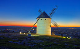 Windmill  at field in evening Stock Photo