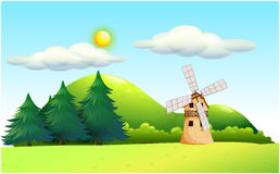 A windmill in the field Royalty Free Stock Images