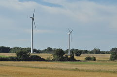 Windmill on the field. Production of energy from wind. Renewable resources. New technologies Royalty Free Stock Images