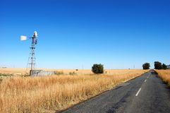 Windmill in Field, South Africa Royalty Free Stock Image
