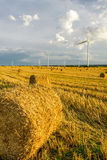 Windmill on the field with stubble Royalty Free Stock Images