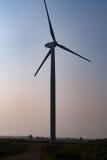 Windmill on field Stock Image