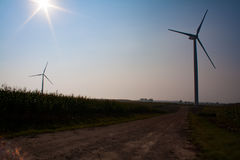 Windmill on field. White windmills on a green field of corn in late summer. / Windmill on field. / Belarus Stock Images