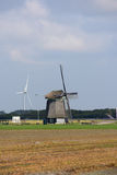 Windmill in the fields with flowers in the foreground Stock Photography